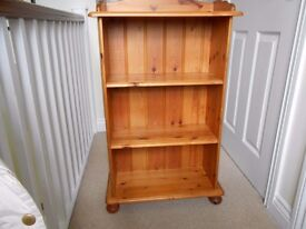 Pine bed frame, pine chest of drawers and pine bookcase