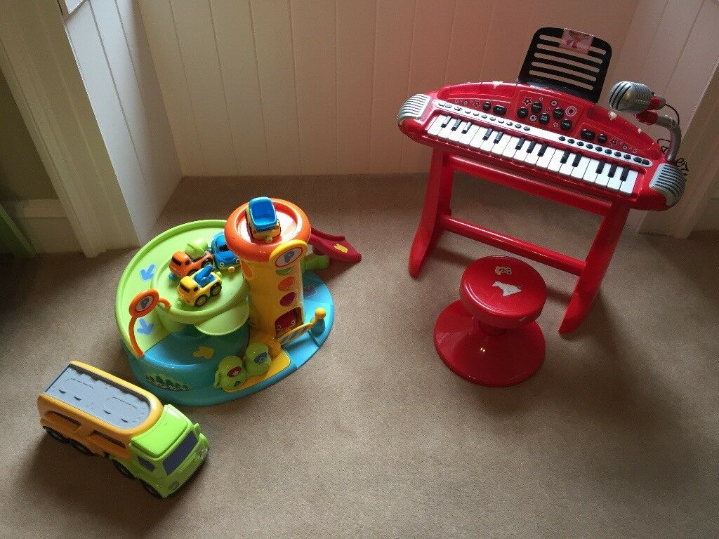Toy Garage and Piano for sale.