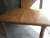 Extending antique pine dining table.