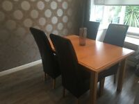 Marks and Spencer solid wood Lichfield extending table and four leather chairs