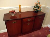 Sideboard mahogany. Solid wood. One middle drawer with 3 cupboards
