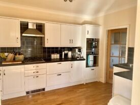 White Shaker style Kitchen and integrated appliances