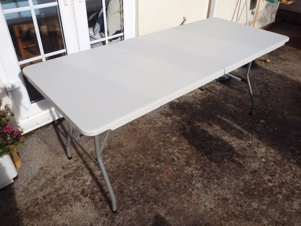 A Substantial 6' long Folding Table (Still boxed and unused)
