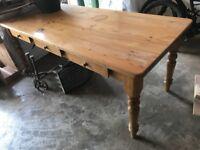 Pine table in need of repair