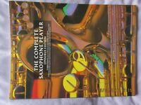 4 saxophone music books plus fingering chart