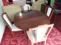 Mahogany round extendable dining table and 4 chairs with cream cushion