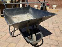 Metal wheelbarrow planter (child size)