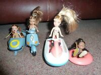 Lil'Bratz Dolls along with a motor bike and side car with an extra of a jet bike