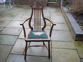 An unusual open sided arm chair with lyre back.