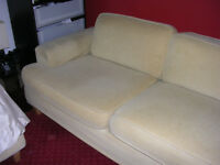 Modern 2 seat sofa, removable covers. Cream Beige coloured