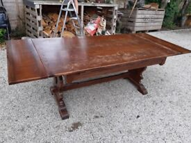 Oak top dining table with extender leafs