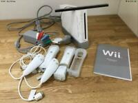 Wii Games Console with Wii Fit Board, Controllers, Wheel and assorted games