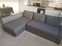 Immaculate grey fabric sofa folds out to a sofa bed also has underneath storage space