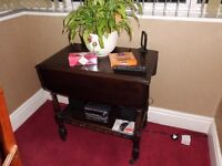 Small dark wood square table with fold down sides