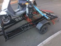 ktm type trailer with a new spare set of wheels,jocky leg,bike straps, ramp, ready &road legal ,