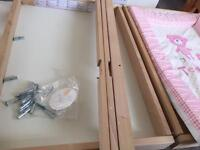 Ikea baby changing table & pink plastic changing mat