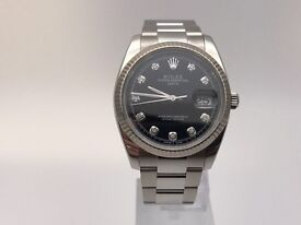 2009 Rolex date with black dot diamond dial