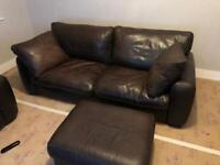 Leather sofas and foot stool.