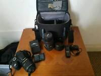 Nixon d3100. 18-55 vr af lens. 70-300 macro Mf lens. Accessories