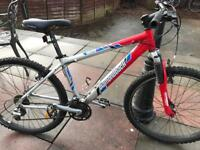 Mountain bike with front suspension 34 speed