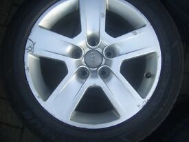 Audi Alloy 5 Stud wheels 16Inch with all matching 205/55/16 Michelin tyres, with centre caps