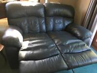 Pair of lovely leather reclining sofas. Will separate