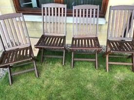 Four wooden outdoor chairs