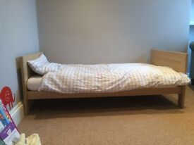 Immaculate children's nursery bed / cot, drawers and wardrobe