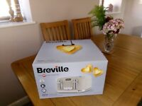 Breville 4 slice Toaster. Brand new in box. Unwanted gift.
