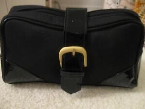BRAND NEW COSMETIC BAG...NEVER USED..JET BLACK  ZIPPERED CLOSURE.
