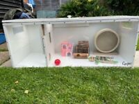 Small animal hamster cage and accessories.