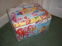 Small upholstered toy box