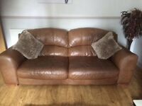 DFS 3 piece suite in tan 3 seater sofa , 2 chairs and a large foot stool