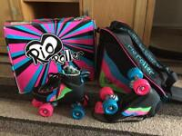 Boxed Rio roller skates and matching bag size 2