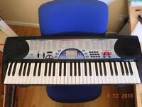 Casio Electronic Keyboard - CTK-471 100 tones, 100 rhythms, 61 full sized keys - boxed with stand