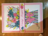 New! Lovely floral tea towel in box.