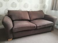 DFS Sofa Bed in very good condition. Brown with oak feet.