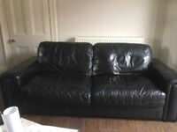 Black leather sofa 2 seater and 3 seater £150. ONO