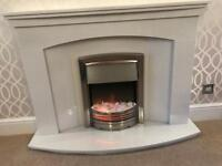 Marble surround electric fire