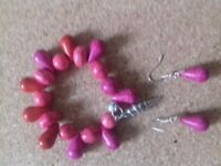 Stunning cerise pink bracelet and drop earrings set.