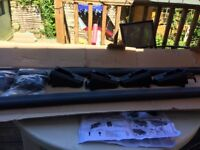 Roof bars, brand new in box. Two bars feet and accessories. Included instructions and cars it fits
