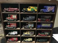 Collection of miniature cars in display cabinet. Ideal for the model enthusiast.