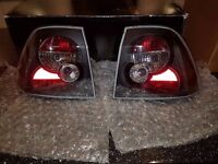 VAUXHALL VECTRA B 1999-2002 HATCH/SALOON BLACK LEXUS REAR TAIL LIGHTS LAMPS PAIR