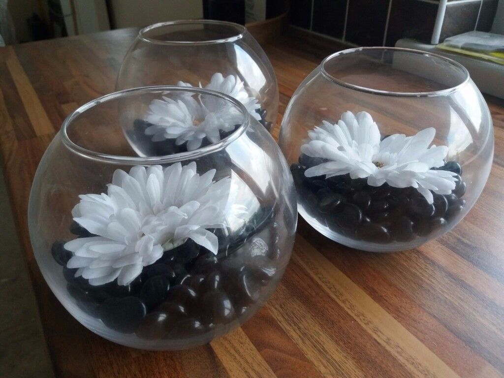 3 Glass Fish Bowl With Black Pebbles And White Flower In Neath