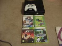 x box 360 slim with 4 games