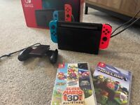 Nintendo Switch and 2 games