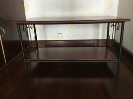 Coffee table with wrought iron legs