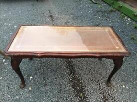 Large glass topped coffee table