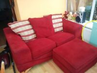 Red 2× 2 seater sofas and footstool
