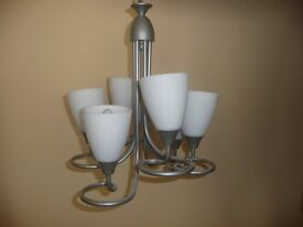 5 arm silver light fitting with white glass shades